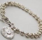 Barrel weave bracelet with charm